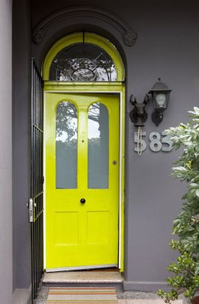 Cerulean door on a gray house, plus more awesome doors on surroundedbypretty.com