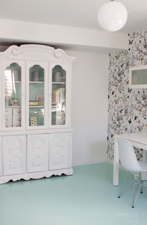 Paint an old china cabinet to match the wall for a sleek look