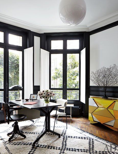 White walls, black window trim, yellow dresser office