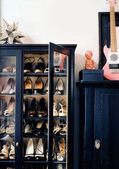 Use a floor cabinet with glass shelves for glam shoe storage.