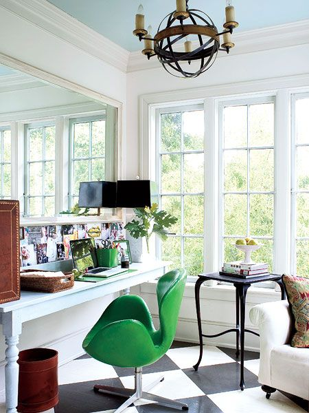Natural light, emerald green chair, black and white floor office
