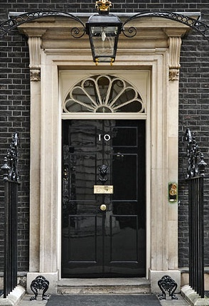 Glossy black door, 10 Downing Street, the locale of British Prime Ministers since 1735. Plus more awesome doors on surroundedbypretty.com