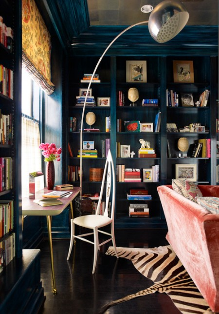 Navy built ins, oversized silver floor lamp, eclectic office.