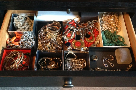 Use jewelry boxes to organize costume jewelry tucked away in a drawer.