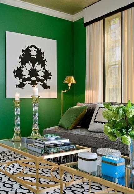 Emerald green living room with black, white, and brass accessories, get the look on surroundedbypretty.com