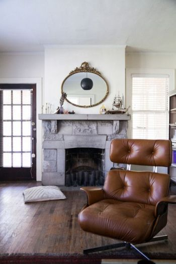 Stunner midcentury leather chair, stone fireplace as a happy place on surroundedbypretty.com