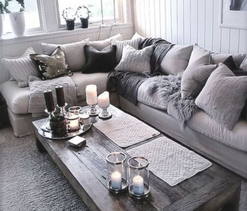 Cool grays, textures, and pillows galore make for a happy place on surroundedbypretty.com